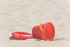 Sandbox with a red bucket. In the summer Royalty Free Stock Photos