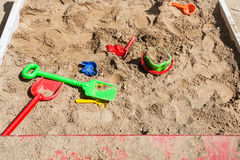 Sandbox with toys on children playground Stock Images
