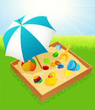 Sandbox with umbrella Stock Photos