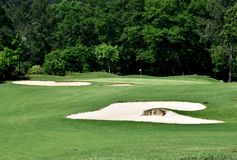 Sandbunker auf Golfplatz Stockbilder