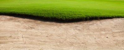 Sandbunker på golfbanan Arkivbilder