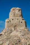 Sandburg auf dem Strand ruinen Stockbild