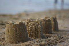 Sandburg auf einem Strand Lizenzfreie Stockbilder