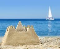 Sandburg auf Strand Stockbilder