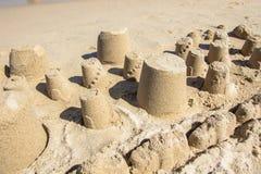 Sandcastle на песчаном пляже Стоковые Фото