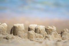 Sandcastle на песчаном пляже Стоковое фото RF