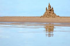 Sandcastle. Background with sandcastle on seacoast Stock Photos