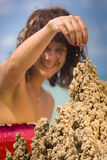 Sandcastle. A woman building a sandcastle on the beach Royalty Free Stock Photography