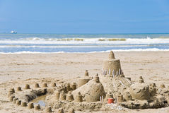 Sandcastle on the beach. Sea on the background Royalty Free Stock Images