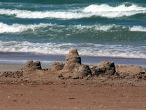 Sandcastle on beach Stock Image