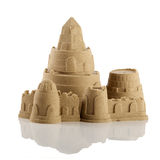 Sandcastle at the beach. Isolated over white Royalty Free Stock Photography
