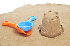Sandcastle and beach shovels Royalty Free Stock Images