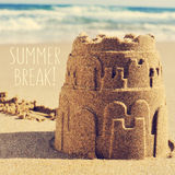 Sandcastle on a beach and the text summer break Stock Images