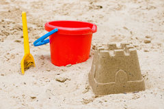 Sandcastle with bucket and shovel Stock Photography