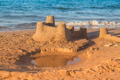 Sandcastle - concept of making save building Royalty Free Stock Images