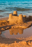 Sandcastle - concept of save building Royalty Free Stock Photos
