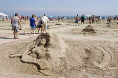 Sandcastle Festival - Cobourg, Ontario July 2011. Visitors to Cobourg Beach admire sculptures built of sand on the shores of Lake Ontario during the Sandcastle Royalty Free Stock Images