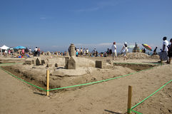Sandcastle Festival - Cobourg, Ontario July 2011. Visitors to Cobourg Beach admire sculptures built of sand on the shores of Lake Ontario during the Sandcastle Stock Photography