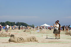 Sandcastle Festival - Cobourg, Ontario July 2011. Visitors to Cobourg Beach photograph sculptures built of sand on the shores of Lake Ontario during the Stock Image