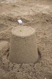 Sandcastle with flower decoration on the top Royalty Free Stock Photography