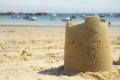 Sandcastle and harbour Stock Photography