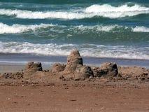 Sandcastle na praia Imagem de Stock