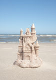Sandcastle By The Ocean Tide Royalty Free Stock Photography
