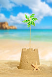 Sandcastle With Pinwheel Stock Photos
