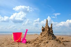 Sandcastle and plastic toys Royalty Free Stock Photos