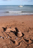 Sandcastle and sailing boat Royalty Free Stock Photography