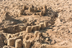 Sandcastle on a sandy beach. Closeup of a sandcastle on a sandy beach stock image
