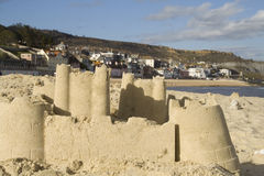Sandcastle at seaside town Stock Image