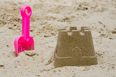 Sandcastle with a shovel Stock Images