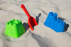 Sandcastle and shovel at the beach Royalty Free Stock Photography