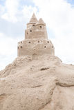 Sandcastle at skies background in Baltic sea. Stock Photo