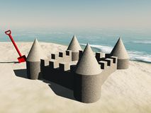 Sandcastle and spade Royalty Free Stock Images