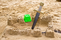 Sandcastle with a sword Stock Photo