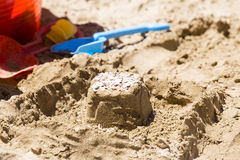 Sandcastle and toy tools Royalty Free Stock Photos