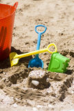 Sandcastle and toy tools Royalty Free Stock Photography