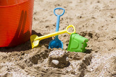Sandcastle and toy tools Royalty Free Stock Photo