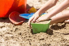 Sandcastle and toy tools Stock Photos
