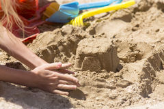 Sandcastle and toy tools Royalty Free Stock Image
