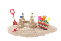 Sandcastle and toys at the beach Stock Image