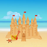 Sandcastle on tropical beach. Summer background. Stock Photo