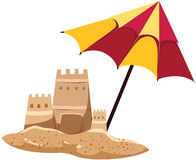 Sandcastle with umbrella Stock Photo