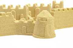Sandcastle Wall And Towers Isolated On White Background Stock Images
