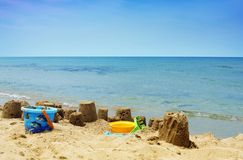 Sandcastles on the beach. Sunny beachside with sandcasles in the surf stock photography