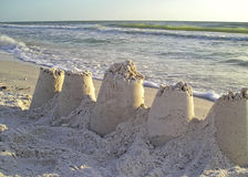 Sandcastles on beach. Sandcastles on a sandy beach with ocean background Royalty Free Stock Image