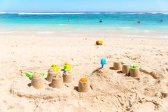 Sandcastles on a beach with the sea in the background.  Royalty Free Stock Photos