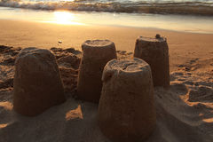 Sandcastles on Beach at Sunset Stock Photography